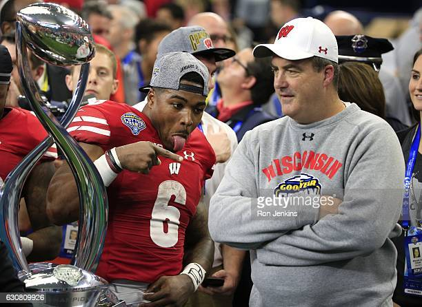 Corey Clement of the Wisconsin Badgers points toward head coach Paul Chryst as the two celebrate following the 81st Goodyear Cotton Bowl at ATT...