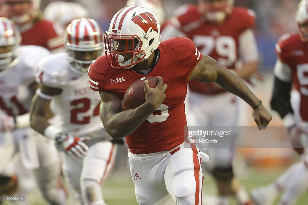 Corey Clement #6 of the Wisconsin Badgers run into the endzone for a touchdown during the second half against the Indiana Hoosiers at Camp Randall Stadium on November 16, 2013 in Madison, Wisconsin.