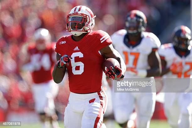 Corey Clement of the Wisconsin Badgers runs for a touchdown during the fourth quarter against the Illinois Fighting Illini at Camp Randall Stadium on...