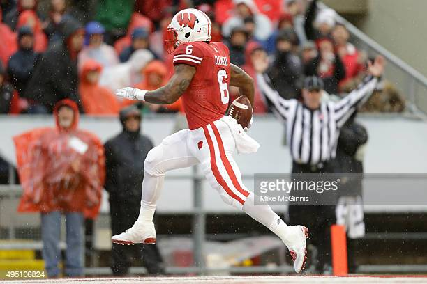 Corey Clement of the Wisconsin Badgers runs in for a touchdown during the first half against the Rutgers Scarlet Knights at Camp Randall Stadium on...