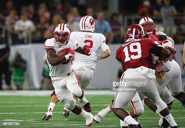 Corey Clement of the Wisconsin Badgers runs the ball against the Alabama Crimson Tide during the Advocare Classic at ATT Stadium on September 5 2015...