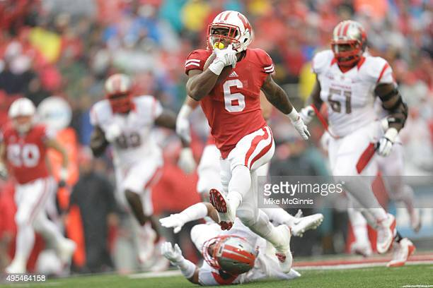 Corey Clement of the Wisconsin Badgers runs upfield with the football during the game against the Rutgers Scarlet Knights at Camp Randall Stadium on...