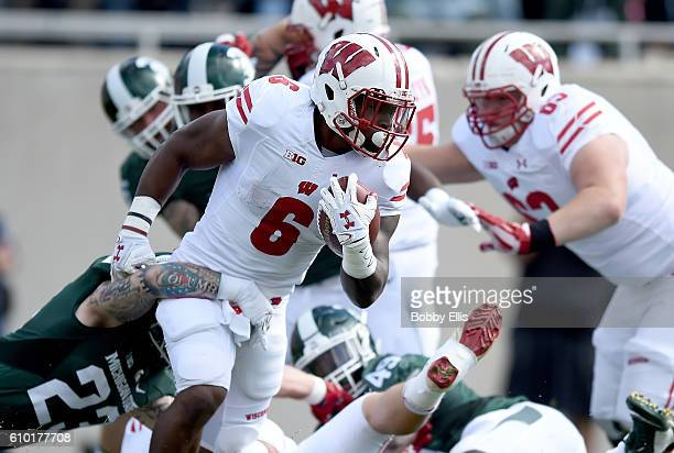 Corey Clement of the Wisconsin Badgers runs with the ball during the game against the Michigan State Spartns at Spartan Stadium on September 24 2016...