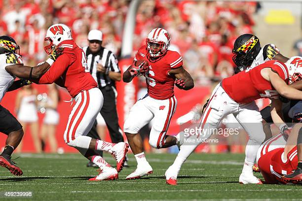 Corey Clement of the Wisconsin Badgers runs with the football during the game against the Maryland Terrapins at Camp Randall Stadium on October 25...