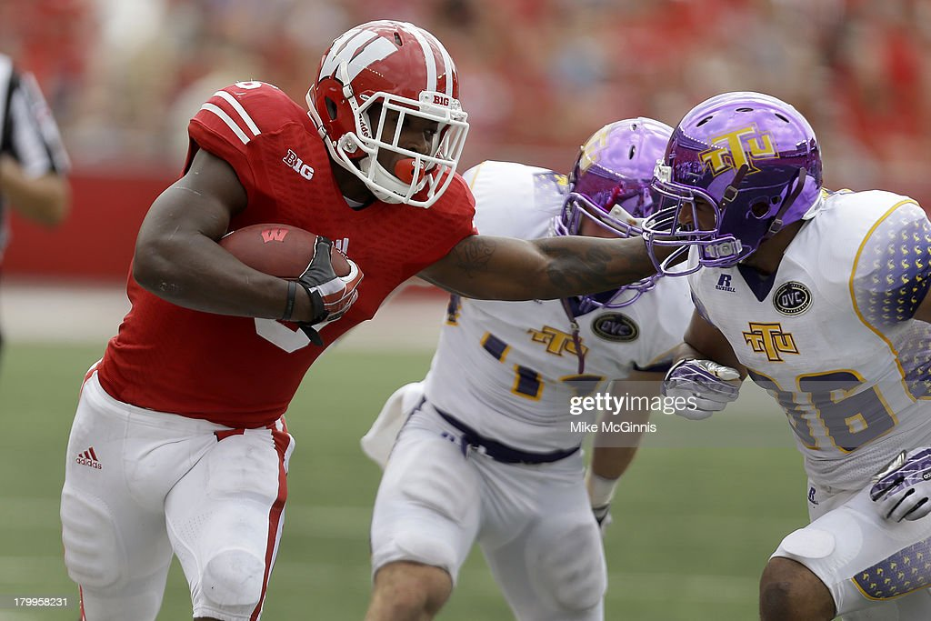 Corey Clement #6 of the Wisconsin Badgers stiff arms Tevin McDermott #36 of the Tennessee Tech Golden Eagles while running upfield during the game at Camp Randall Stadium on September 07, 2013 in Madison, Wisconsin.