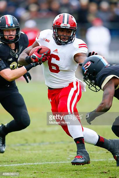Corey Clement of the Wisconsin Badgers tries to hold off a Purdue Boilermakers tackler at RossAde Stadium on November 8 2014 in West Lafayette...