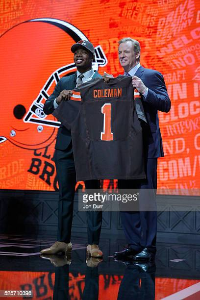 Corey Coleman of Baylor holds up a jersey with NFL Commissioner Roger Goodell after being picked overall by the Cleveland Browns during the first...