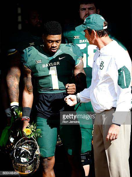 Corey Coleman of the Baylor Bears and head coach Art Briles meet before the Bears take on the Texas Longhorns at McLane Stadium on December 5 2015 in...