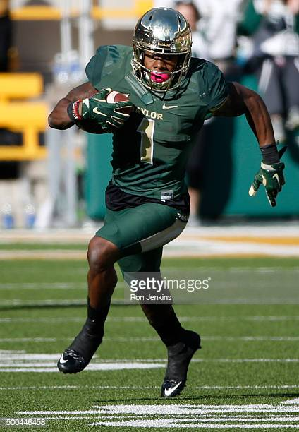 Corey Coleman of the Baylor Bears runs the ball down field against the Texas Longhorns in the fourth quarter at McLane Stadium on December 5 2015 in...