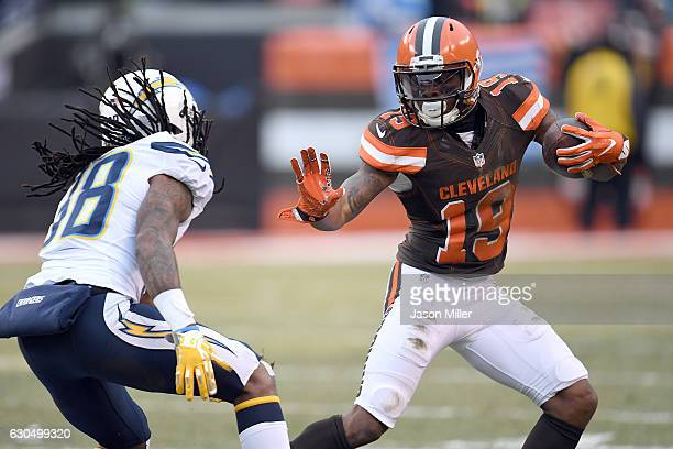 Corey Coleman of the Cleveland Browns runs after the catch against Trovon Reed of the San Diego Chargers at FirstEnergy Stadium on December 24 2016...