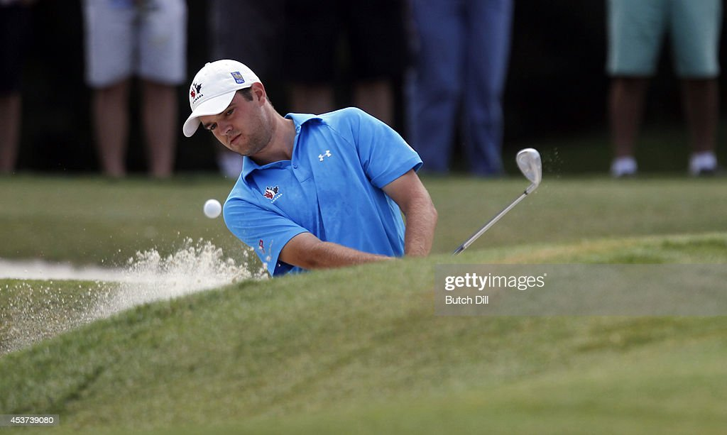Corey Conners, of Canada, hits out of the bunker on the fifth hole during the final match of the U.S. Amateur Championship on August 17, 2014 at the Atlanta Athletic Club in Johns Creek, Georgia.
