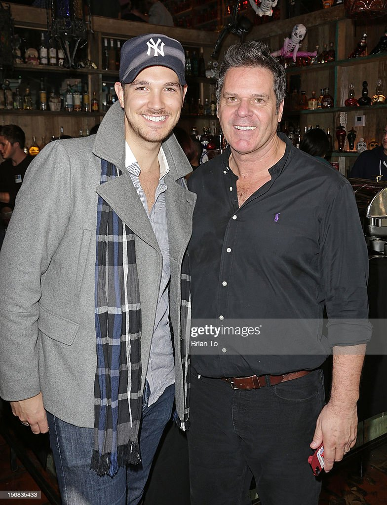 Corey Conrad (L) and Jim Uhl attend PATH's 4th Annual Thanksgiving Meal at Pink Taco on November 22, 2012 in Los Angeles, California.