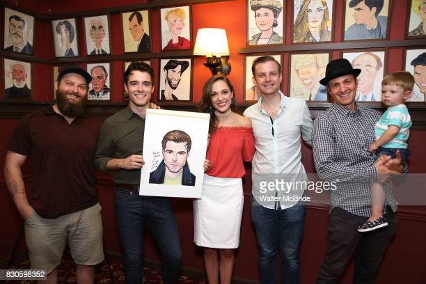 Corey Cott and Laura Osnes with the cast band during the Corey Cott Sardi's Portrait unveiling at Sardi's Restaurant on August 11 2017 in New York...