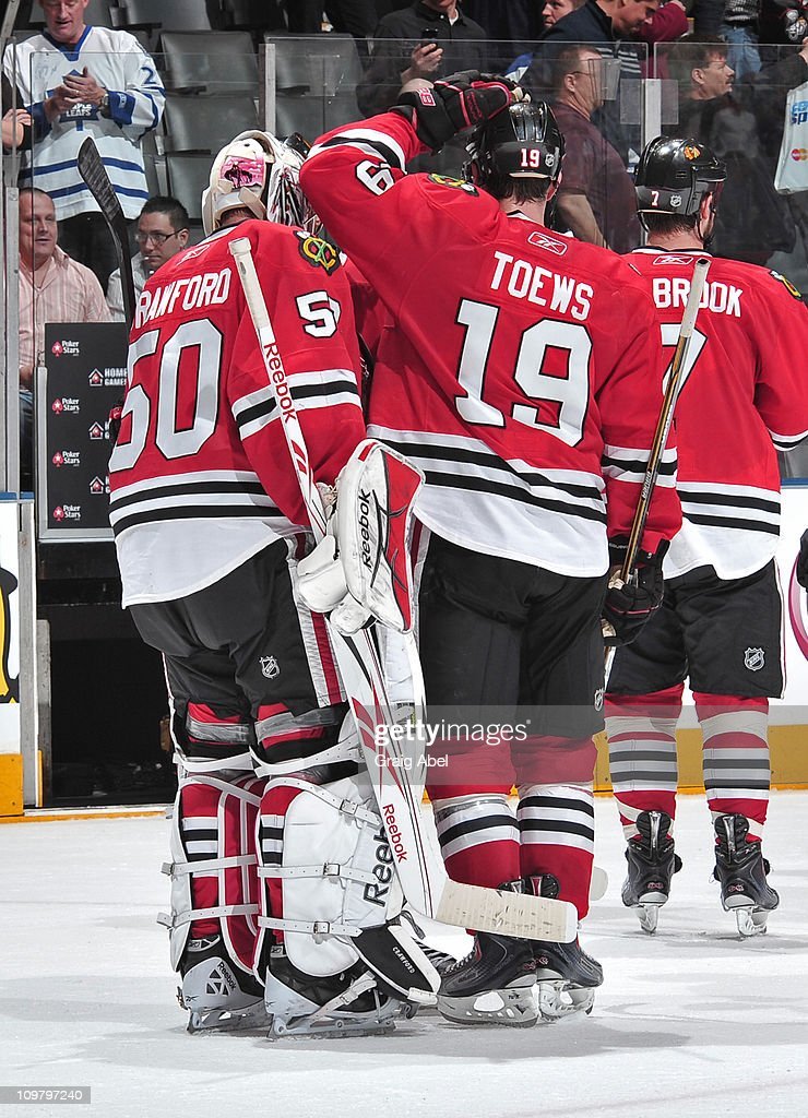 Corey Crawford #50 and <a gi-track='captionPersonalityLinkClicked' href=/galleries/search?phrase=Jonathan+Toews&family=editorial&specificpeople=537799 ng-click='$event.stopPropagation()'>Jonathan Toews</a> #19 of the Chicago Blackhawks celebrate the teams win over the Toronto Maple Leafs March 5, 2011 at the Air Canada Centre in Toronto, Ontario, Canada.