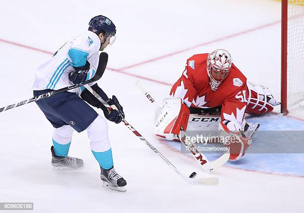 Corey Crawford of Team Canada stops Tobias Rieder of Team Europe on a breakaway during the World Cup of Hockey tournament at the Air Canada Centre on...