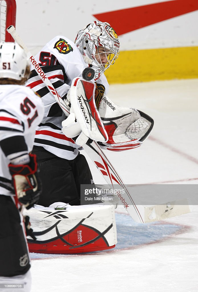 Corey Crawford #50 of the Chicago Black Hawks makes a save in third period action at Scotiabank Saddledome February 7, 2011 in Calgary, Alberta, Canada.
