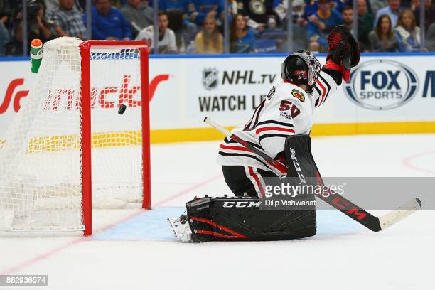 Corey Crawford of the Chicago Blackhawks allows a goal against the St Louis Blues in the third period at the Scottrade Center on October 18 2017 in...