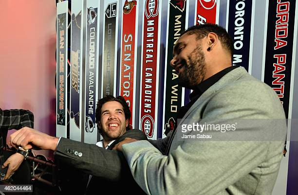 Corey Crawford of the Chicago Blackhawks and Dustin Byfuglien of the Winnipeg Jets laugh before the NHL AllStar Fantasy Draft as part of the 2015 NHL...