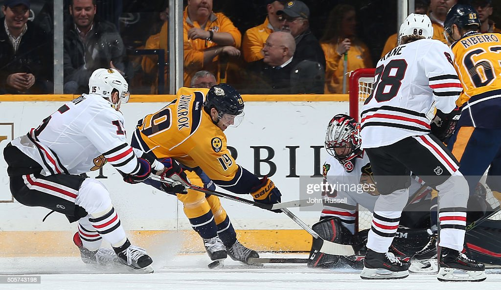 Corey Crawford #50 of the Chicago Blackhawks blocks the shot of Calle Jarnkrok #19 of the Nashville Predators during an NHL game at Bridgestone Arena on January 19, 2016 in Nashville, Tennessee.