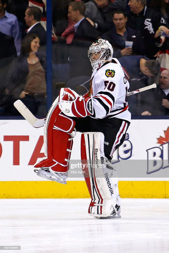 <a gi-track='captionPersonalityLinkClicked' href=/galleries/search?phrase=Corey+Crawford&family=editorial&specificpeople=818935 ng-click='$event.stopPropagation()'>Corey Crawford</a> #50 of the Chicago Blackhawks celebrates after defeating the Columbus Blue Jackets 2-1 in a shootout on March 14, 2013 at Nationwide Arena in Columbus, Ohio.