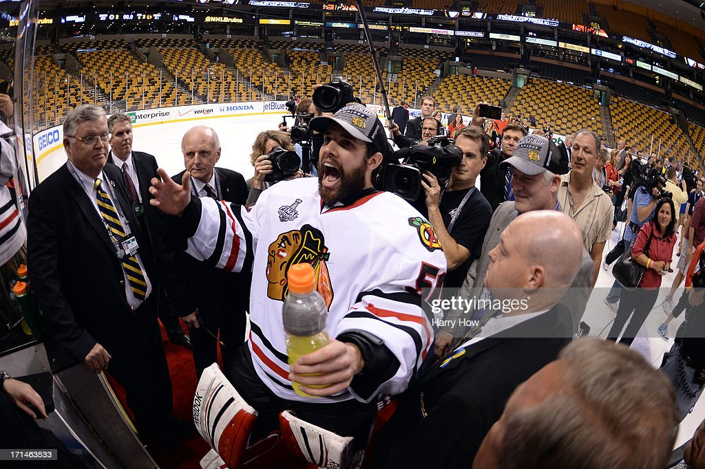 Corey Crawford #50 of the Chicago Blackhawks celebrates following their 3-2 win against the Boston Bruins in Game Six of the 2013 NHL Stanley Cup Final at TD Garden on June 24, 2013 in Boston, Massachusetts.