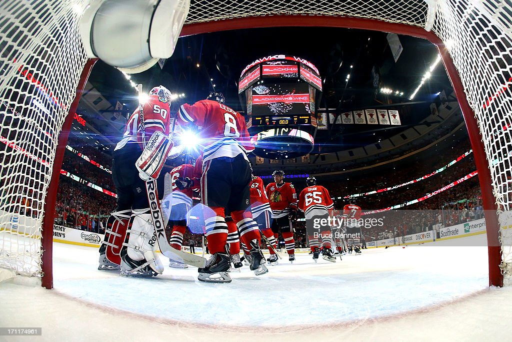 <a gi-track='captionPersonalityLinkClicked' href=/galleries/search?phrase=Corey+Crawford&family=editorial&specificpeople=818935 ng-click='$event.stopPropagation()'>Corey Crawford</a> #50 of the Chicago Blackhawks celebrates with his teammates after defeating the Boston Bruins in Game Five of the 2013 NHL Stanley Cup Final at United Center on June 22, 2013 in Chicago, Illinois. The Chicago Blackhawks defeated the Boston Bruins 3-1.