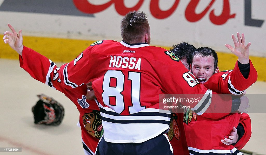<a gi-track='captionPersonalityLinkClicked' href=/galleries/search?phrase=Corey+Crawford&family=editorial&specificpeople=818935 ng-click='$event.stopPropagation()'>Corey Crawford</a> #50 of the Chicago Blackhawks celebrates with teammates <a gi-track='captionPersonalityLinkClicked' href=/galleries/search?phrase=Marian+Hossa&family=editorial&specificpeople=202233 ng-click='$event.stopPropagation()'>Marian Hossa</a> #81, <a gi-track='captionPersonalityLinkClicked' href=/galleries/search?phrase=Andrew+Shaw+-+Jogador+de+h%C3%B3quei+no+gelo&family=editorial&specificpeople=10568695 ng-click='$event.stopPropagation()'>Andrew Shaw</a> #65 and <a gi-track='captionPersonalityLinkClicked' href=/galleries/search?phrase=Jonathan+Toews&family=editorial&specificpeople=537799 ng-click='$event.stopPropagation()'>Jonathan Toews</a> #19 after defeating the Tampa Bay Lightning by a score of 2-0 in Game Six to win the 2015 NHL Stanley Cup Final at the United Center on June 15, 2015 in Chicago, Illinois.