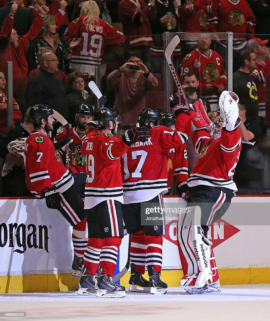 <a gi-track='captionPersonalityLinkClicked' href=/galleries/search?phrase=Corey+Crawford&family=editorial&specificpeople=818935 ng-click='$event.stopPropagation()'>Corey Crawford</a> #50 of the Chicago Blackhawks (R) celebrates with teammates including (L-R) <a gi-track='captionPersonalityLinkClicked' href=/galleries/search?phrase=Brent+Seabrook&family=editorial&specificpeople=638862 ng-click='$event.stopPropagation()'>Brent Seabrook</a> #7, <a gi-track='captionPersonalityLinkClicked' href=/galleries/search?phrase=Jonathan+Toews&family=editorial&specificpeople=537799 ng-click='$event.stopPropagation()'>Jonathan Toews</a> #19 and <a gi-track='captionPersonalityLinkClicked' href=/galleries/search?phrase=Sheldon+Brookbank&family=editorial&specificpeople=586095 ng-click='$event.stopPropagation()'>Sheldon Brookbank</a> #17 after a win over the Minnesota Wild in Game Five of the Second Round of the 2014 NHL Stanley Cup Playoffs at the United Center on May 11, 2014 in Chicago, Illinois. The Blackhawks defeated the Wild 2-1.