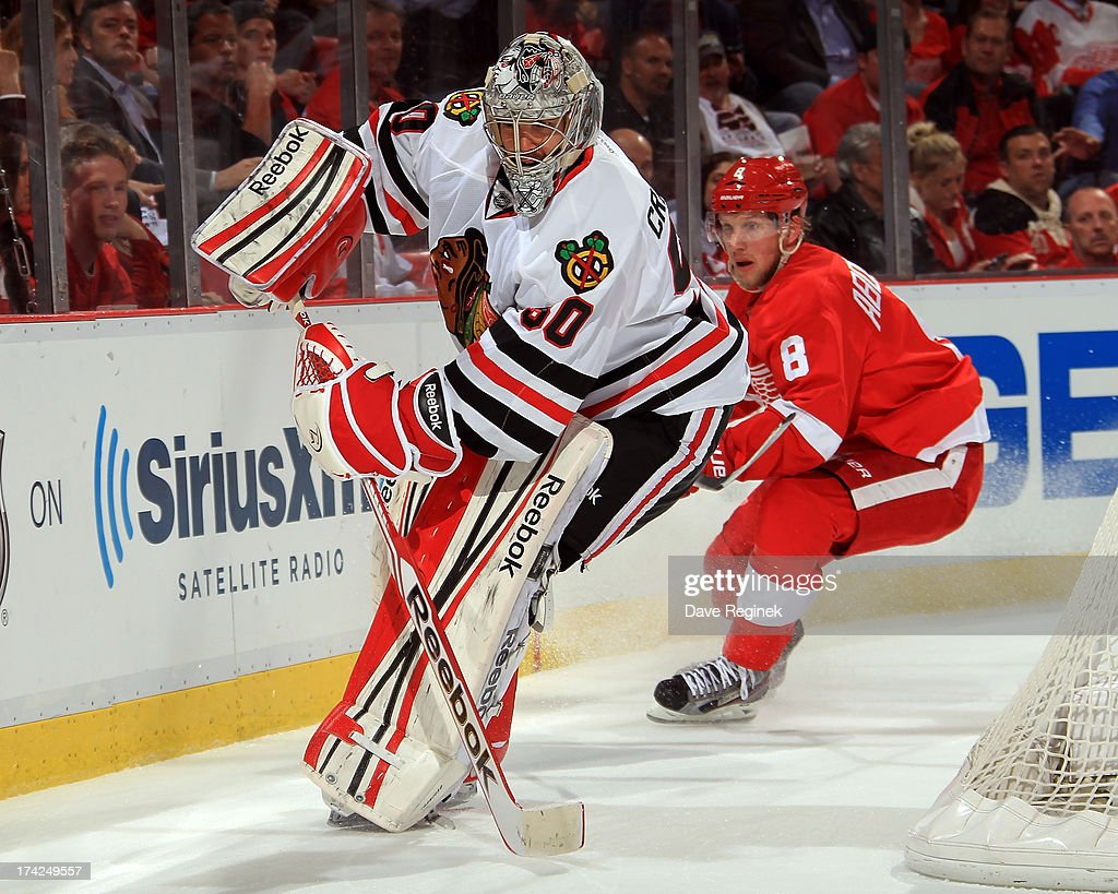 Corey Crawford #50 of the Chicago Blackhawks clears the puck during Game Four of the Western Conference Semifinals against the Detroit Red Wings during the 2013 NHL Stanley Cup Playoffs at Joe Louis Arena on May 23, 2013 in Detroit, Michigan. The Wings won 2-0
