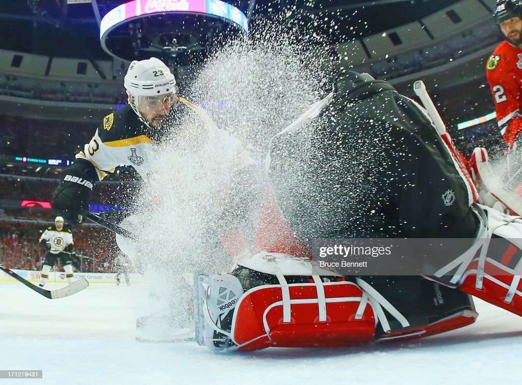<a gi-track='captionPersonalityLinkClicked' href=/galleries/search?phrase=Corey+Crawford&family=editorial&specificpeople=818935 ng-click='$event.stopPropagation()'>Corey Crawford</a> #50 of the Chicago Blackhawks defends the net against Chris Kelly #23 of the Boston Bruins in Game Five of the 2013 NHL Stanley Cup Final at United Center on June 22, 2013 in Chicago, Illinois. The Chicago Blackhawks defeated the Boston Bruins 3-1.