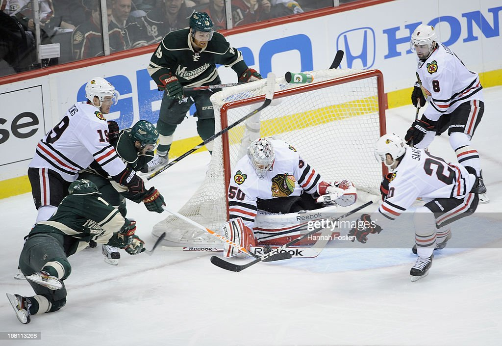 Corey Crawford #50 of the Chicago Blackhawks deflects a shot by Torrey Mitchell #17 of the Minnesota Wild during the first period of Game Three of the Western Conference Quarterfinals during the 2013 NHL Stanley Cup Playoffs at Xcel Energy Center on May 5, 2013 in St Paul, Minnesota.
