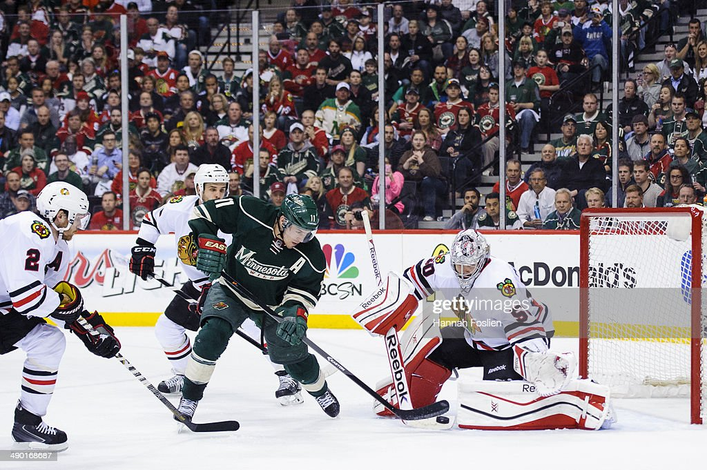 Corey Crawford #50 of the Chicago Blackhawks deflects a shot by Zach Parise #11 of the Minnesota Wild as Duncan Keith #2 and Niklas Hjalmarsson #4 of the Chicago Blackhawks looks on in Game Four of the Second Round of the 2014 NHL Stanley Cup Playoffs on May 9, 2014 at Xcel Energy Center in St Paul, Minnesota. The Wild defeated the Blackhawks 4-2.