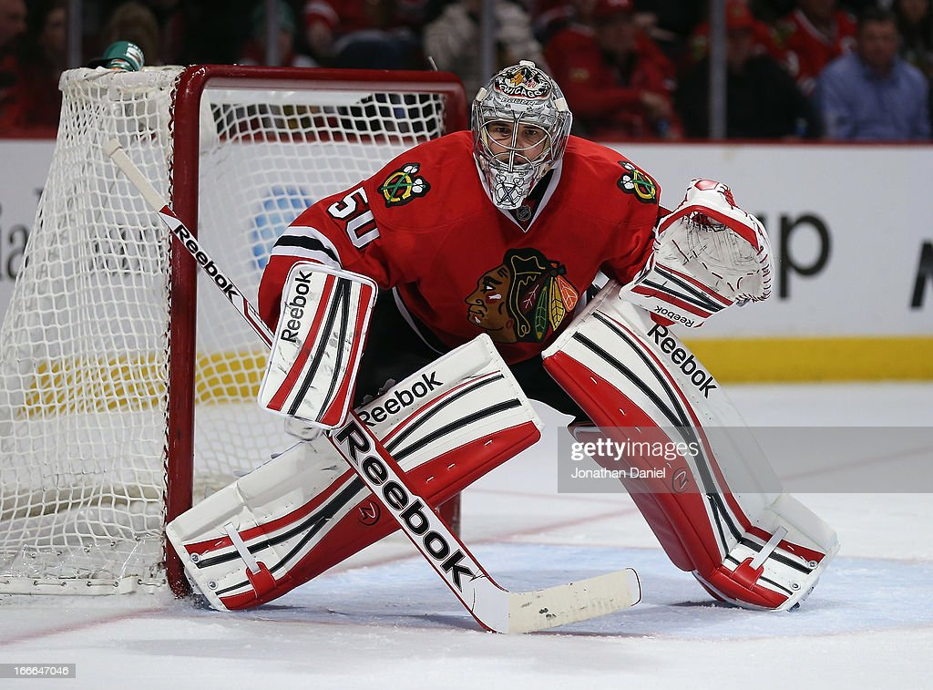 <a gi-track='captionPersonalityLinkClicked' href=/galleries/search?phrase=Corey+Crawford&family=editorial&specificpeople=818935 ng-click='$event.stopPropagation()'>Corey Crawford</a> #50 of the Chicago Blackhawks follows the action against the Detroit Red Wings at the United Center on April 12, 2013 in Chicago, Illinois. The Blackhawks defeated the Redwings 3-2 in a shootout.