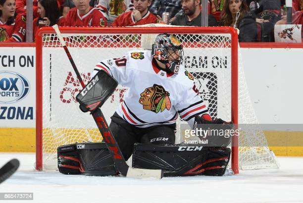 Corey Crawford of the Chicago Blackhawks gets ready to make a save against the Arizona Coyotes at Gila River Arena on October 21 2017 in Glendale...