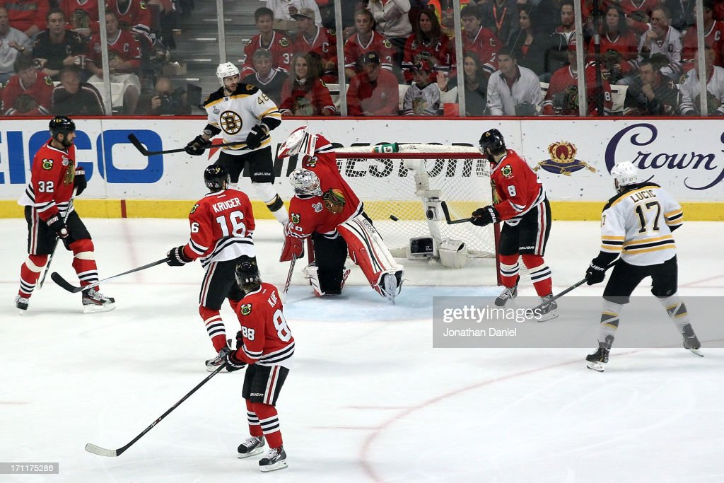 <a gi-track='captionPersonalityLinkClicked' href=/galleries/search?phrase=Corey+Crawford&family=editorial&specificpeople=818935 ng-click='$event.stopPropagation()'>Corey Crawford</a> #50 of the Chicago Blackhawks gives up a goal scored by Zdeno Chara #33 of the Boston Bruins in the third period of Game Five of the 2013 NHL Stanley Cup Final at United Center on June 22, 2013 in Chicago, Illinois.