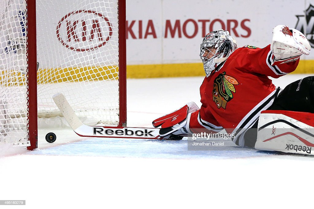 Corey Crawford #50 of the Chicago Blackhawks gives up a goal to Justin Williams #14 of the Los Angeles Kings in the first period during Game Seven of the Western Conference Final in the 2014 Stanley Cup Playoffs at United Center on June 1, 2014 in Chicago, Illinois.