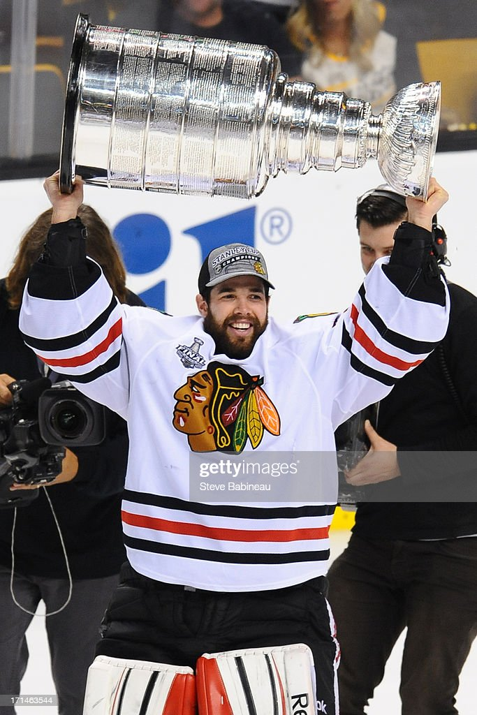 Corey Crawford #50 of the Chicago Blackhawks hoists the Stanley Cup after the win against the Boston Bruins in Game Six of the Stanley Cup Final at TD Garden on June 24, 2013 in Boston, Massachusetts.