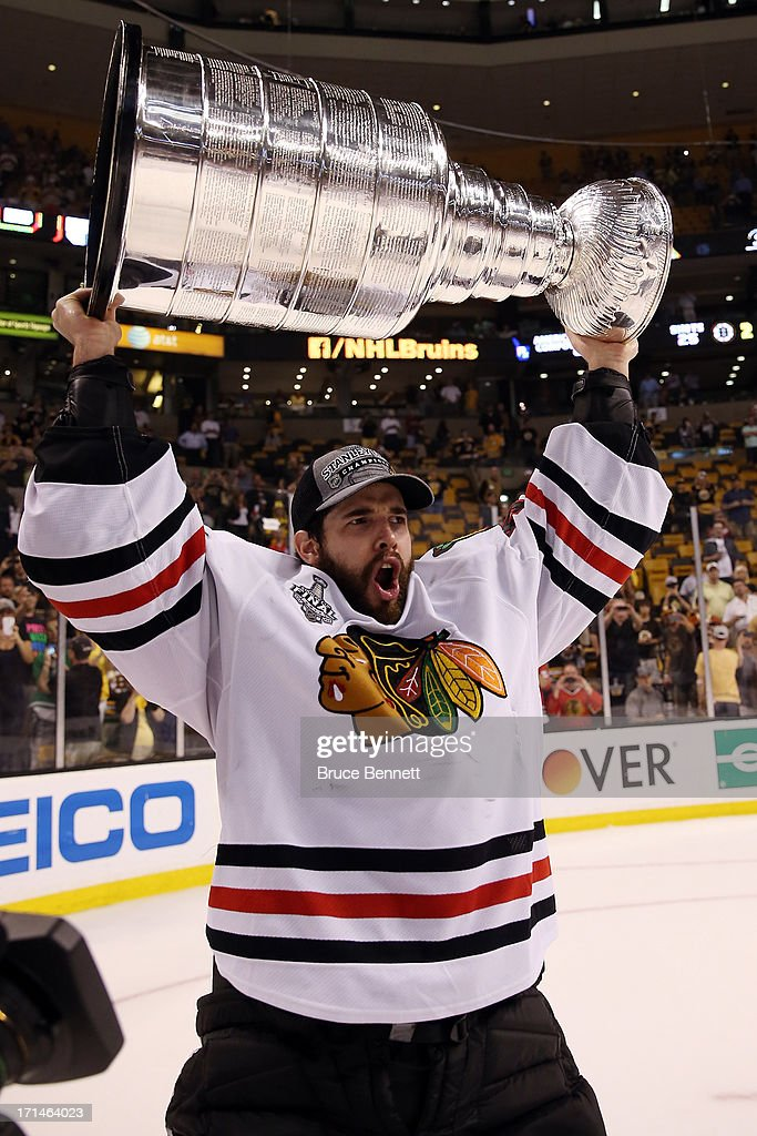 Corey Crawford #50 of the Chicago Blackhawks hoists the Stanley Cup Trophy after defeating the Boston Bruins in Game Six of the 2013 NHL Stanley Cup Final at TD Garden on June 24, 2013 in Boston, Massachusetts. The Chicago Blackhawks defeated the Boston Bruins 3-2.