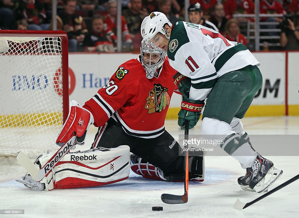 Corey Crawford #50 of the Chicago Blackhawks keeps his eyes on Zach Parise #11 of the Minnesota Wild in Game Five of the Second Round of the 2014 NHL Stanley Cup Playoffs at the United Center on May 11, 2014 in Chicago, Illinois. The Blackhawks defeated the Wild 2-1.