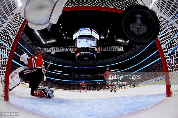 Corey Crawford of the Chicago Blackhawks lets in a first period goal by Ryan Callahan of the Tampa Bay Lightning during Game Three of the 2015 NHL...
