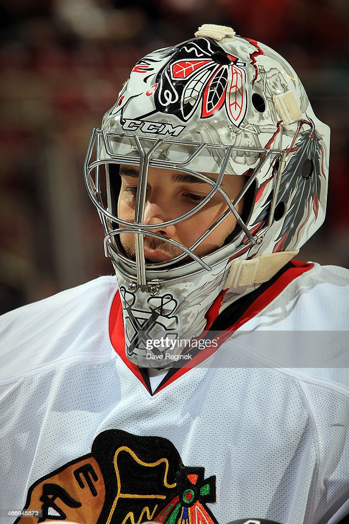 Corey Crawford #50 of the Chicago Blackhawks \looks down the ice against the Detroit Red Wings during an NHL game on January 22, 2014 at Joe Louis Arena in Detroit, Michigan. Detroit defeated Chicago 5-4 in a shootout