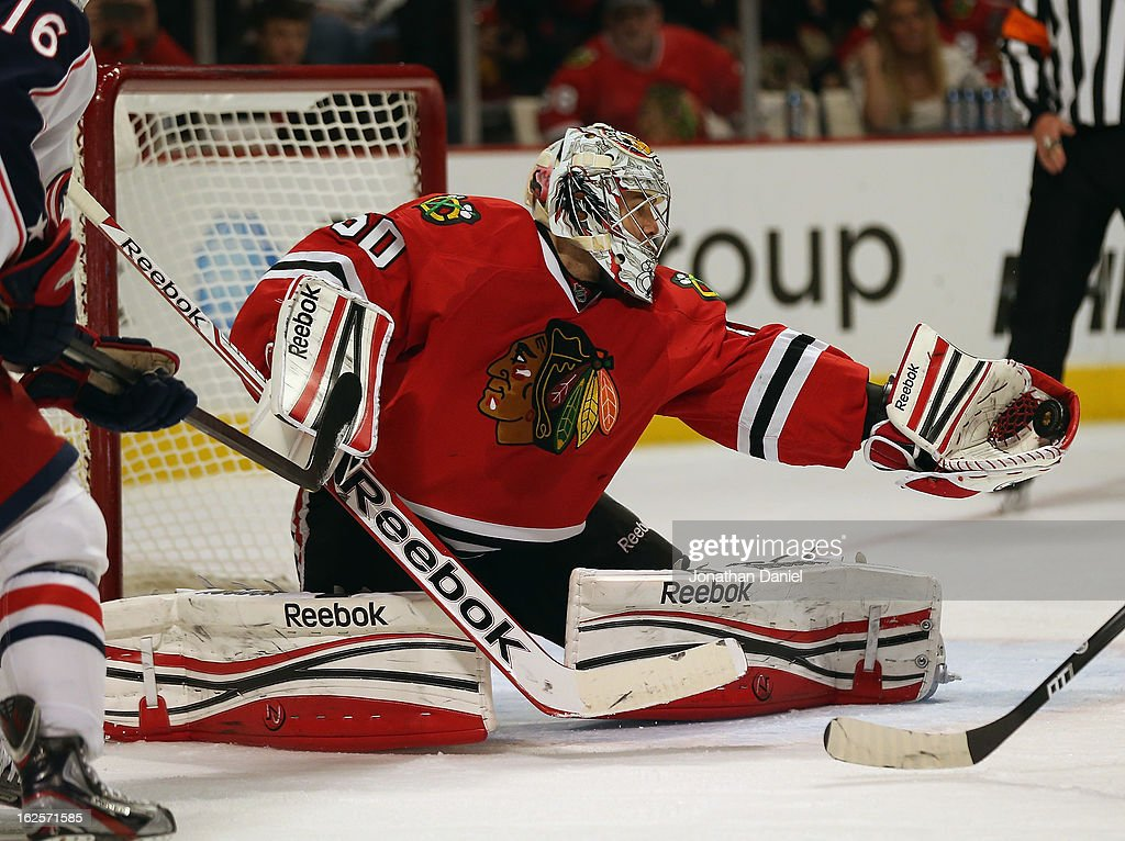 <a gi-track='captionPersonalityLinkClicked' href=/galleries/search?phrase=Corey+Crawford&family=editorial&specificpeople=818935 ng-click='$event.stopPropagation()'>Corey Crawford</a> #50 of the Chicago Blackhawks makes a glove save against the Columbus Blue Jackets at the United Center on February 24, 2013 in Chicago, Illinois.