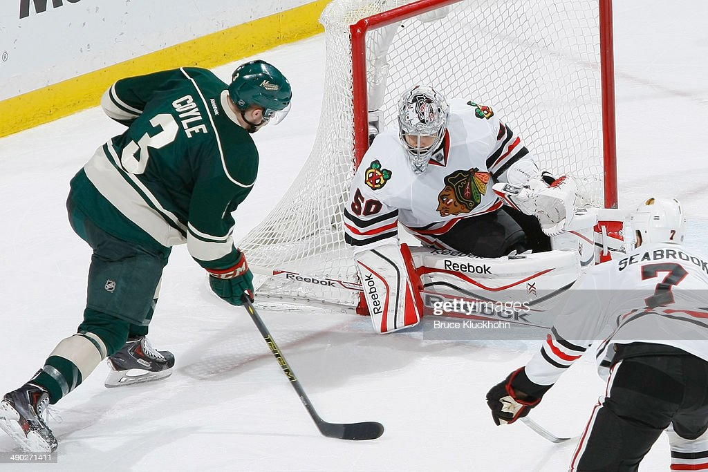 <a gi-track='captionPersonalityLinkClicked' href=/galleries/search?phrase=Corey+Crawford&family=editorial&specificpeople=818935 ng-click='$event.stopPropagation()'>Corey Crawford</a> #50 of the Chicago Blackhawks makes a save against <a gi-track='captionPersonalityLinkClicked' href=/galleries/search?phrase=Charlie+Coyle&family=editorial&specificpeople=7029381 ng-click='$event.stopPropagation()'>Charlie Coyle</a> #3 of the Minnesota Wild during Game Six of the Second Round of the 2014 Stanley Cup Playoffs on May 13, 2014 at the Xcel Energy Center in St. Paul, Minnesota.
