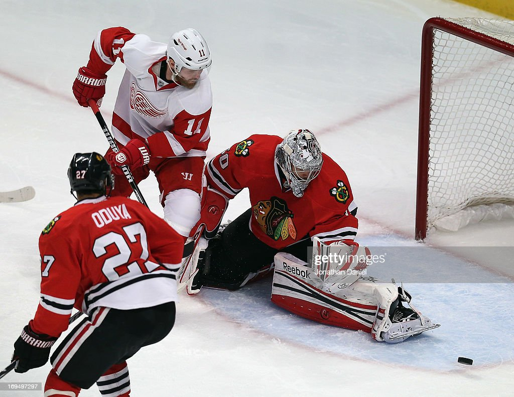 <a gi-track='captionPersonalityLinkClicked' href=/galleries/search?phrase=Corey+Crawford&family=editorial&specificpeople=818935 ng-click='$event.stopPropagation()'>Corey Crawford</a> #50 of the Chicago Blackhawks makes a save against <a gi-track='captionPersonalityLinkClicked' href=/galleries/search?phrase=Daniel+Cleary&family=editorial&specificpeople=220490 ng-click='$event.stopPropagation()'>Daniel Cleary</a> #11 of the Detroit Red Wings as <a gi-track='captionPersonalityLinkClicked' href=/galleries/search?phrase=Johnny+Oduya&family=editorial&specificpeople=3944055 ng-click='$event.stopPropagation()'>Johnny Oduya</a> #27 defends in Game Five of the Western Conference Semifinals during the 2013 NHL Stanley Cup Playoffs at the United Center on May 25, 2013 in Chicago, Illinois. The Blackhawks defeated the Red Wings 4-1.