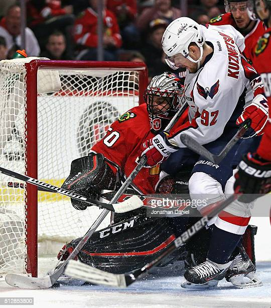 Corey Crawford of the Chicago Blackhawks makes a save against Evgeny Kuznetsov of the Washington Capitals at the United Center on February 28 2016 in...