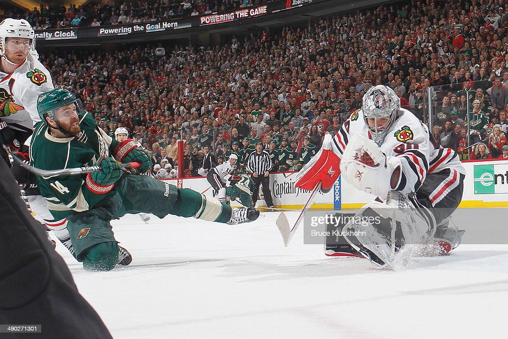 <a gi-track='captionPersonalityLinkClicked' href=/galleries/search?phrase=Corey+Crawford&family=editorial&specificpeople=818935 ng-click='$event.stopPropagation()'>Corey Crawford</a> #50 of the Chicago Blackhawks makes a save against <a gi-track='captionPersonalityLinkClicked' href=/galleries/search?phrase=Justin+Fontaine&family=editorial&specificpeople=8312194 ng-click='$event.stopPropagation()'>Justin Fontaine</a> #14 of the Minnesota Wild during Game Six of the Second Round of the 2014 Stanley Cup Playoffs on May 13, 2014 at the Xcel Energy Center in St. Paul, Minnesota.