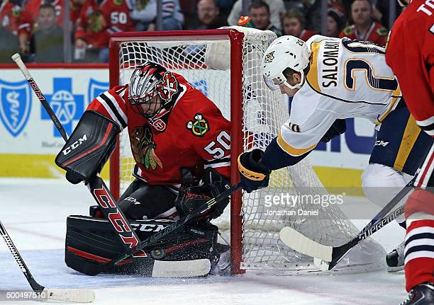 Corey Crawford of the Chicago Blackhawks makes a save against Miikka Salomaki of the Nashville Predators at United Center on December 8 2015 in...