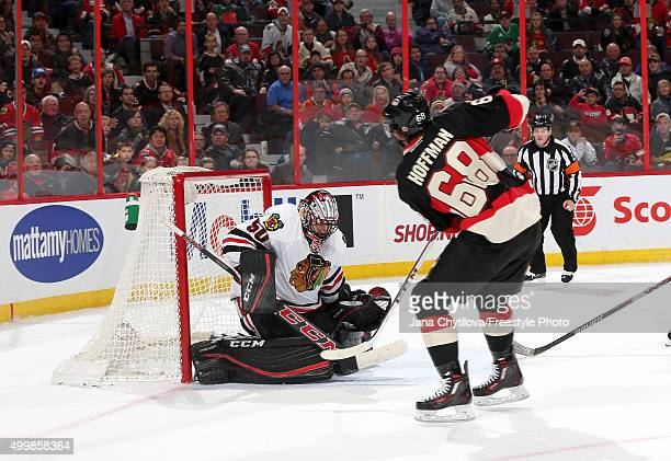 Corey Crawford of the Chicago Blackhawks makes a save against Mike Hoffman of the Ottawa Senators during an NHL game at Canadian Tire Centre on...