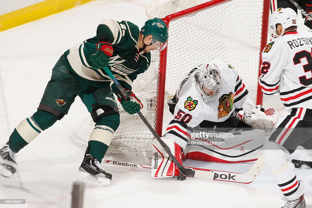 Corey Crawford #50 of the Chicago Blackhawks makes a save against Nino Niederreiter #22 of the Minnesota Wild during Game Three of the Second Round of the 2014 Stanley Cup Playoffs on May 6, 2014 at the Xcel Energy Center in St. Paul, Minnesota.