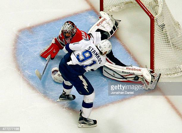 Corey Crawford of the Chicago Blackhawks makes a save against Steven Stamkos of the Tampa Bay Lightning during the second period in Game Six of the...